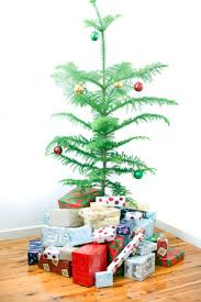 photo of small natural pine christmas tree with gifts free