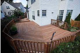 wrap around deck designs before and after wrap around deck makeover featuring trex enhance