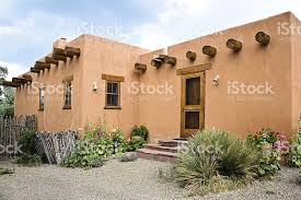 adobe house santa fe old adobe house with stucco wall and flowers stock photo