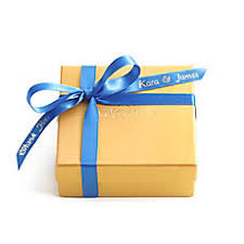 blue and gold ribbon blue gifts and chocolate party favors godiva