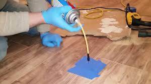 Glue Laminate Floor Laminate Flooring Repair To Fix Soft Spot For Uneven Underlayment