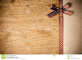 brown ribbon background with brown ribbon and kraft paper stock photography