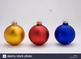 three tree bulb ornaments on white background studio