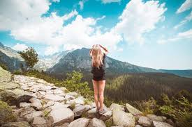 the traveler images Young woman traveler enjoying a view on high tatras mountains free jpg