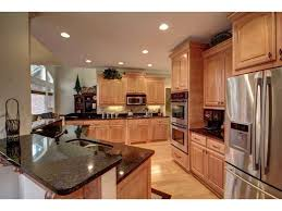 Kitchen With Light Cabinets Kitchen Stainless Steel Dark Granite Counter Tops Light Wood