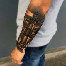 outer forearm badass male lighthouse shaded black and grey ink