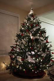 Decorating Christmas Tree Without Lights by Ornate Silver Hanging Garnish And White Garland Lights Mixed Red