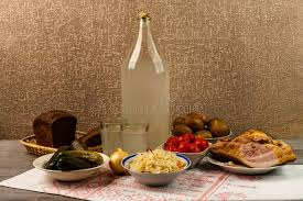 table snack cuisine national drink and snack the big bottle and glass of