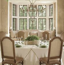 dining rooms window seating beige benches metal chandelier round