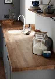 a classically inspired swan neck tap and a solid oak block worktop