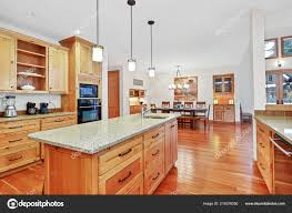 light kitchen cabinets countertops amazing kitchen with light wood cabinets granite counter tops and black appliances 219376250
