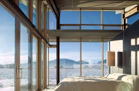 bedroom floor to ceiling windows glass farmhouse in northeast oregon