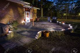 patio with solar lights and sand set bricks just after sunset