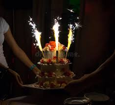 birthday cake sparklers celebration cake with candles and cake sparklers stock photo