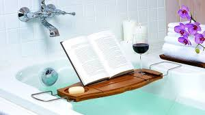 relax in the bathtub with some with umbra s bath caddy