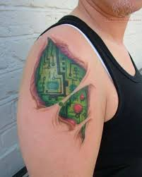 color ink ripped skin chip tattoo on right shoulder