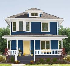 yellow exterior paint exterior paint with blue on the wall white on the window s and