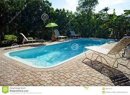 rectangular swimming pool with deck chairs stock images image