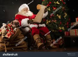 At Home Christmas Trees by Portrait Happy Santa Claus Sitting His Stock Photo 160197746