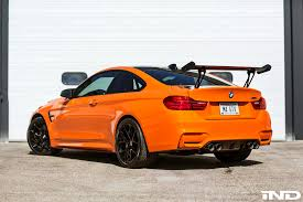modded sports cars fire orange bmw m4 modded by ind distribution