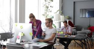 track across table in casual startup office with happy