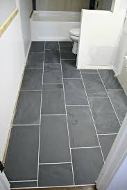 how to tile a bathroom floor it s done from thrifty decor