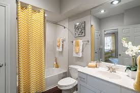 bathroom interior curtain with chevron stripes brings yellow to