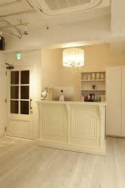 Small Space Salon Ideas - home office stylish ikea reception desk with white stools for