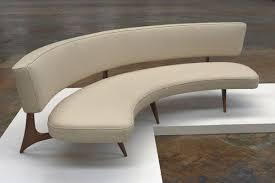 modern curved sofa floating curved sofa on elegant carved base curves mid century