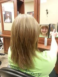 rounded layer haircuts blonde medium long shag textured haircut soft rounded full
