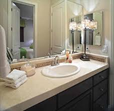 Bathroom Designs Frames Over Wooden Vanity As Well Midcentury Guest Bathroom Design