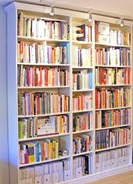 Bookcases With Glass Shelves Large White Wooden Bookcase With Glass Shelves And Black Fireplace