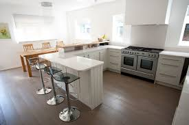 Off White Shaker Kitchen Cabinets Painted Cream Shaker Kitchen With Oak Breakfast Bar And Quartz