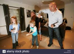 family play wii home console together in their sitting