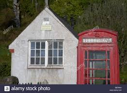 tiny small telephone exchange and red telephone stock photo