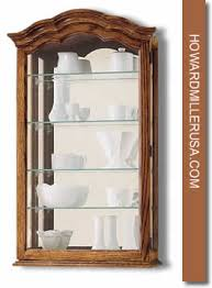 Wall Mounted Cabinet With Glass Doors by Howard Miller Oak Wall Mounting Display Cabinet Glass Mirrored 685102