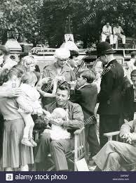 Jayne Mansfield House by Jayne Mansfield And Husband Mickey Hargitay Holding Son Zoltan