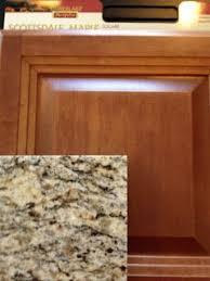maple cognac kitchen cabinets santa cecilia granite counter tops