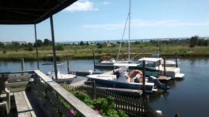 a view of the harbor at the west dennis yacht club in cape cod ma