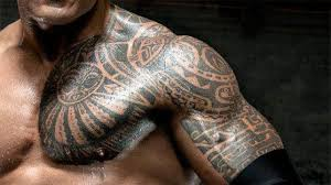 cool tribal on chest and left half sleeve