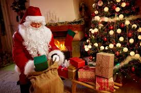 deliver presents santa claus deliver presents in home next christmas tree stock