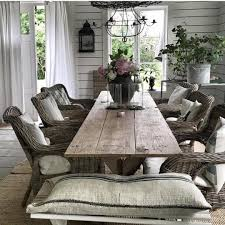 dining room with farmhouse table and wicker chairs rustic