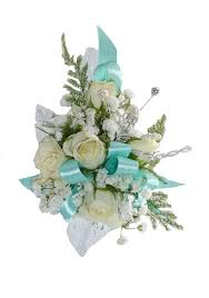 teal corsage a gorgeous corsage complete with white roses and light teal trim