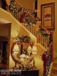 christmas decor along window sill and a single ornament hanging