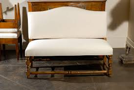 furniture white upholstered bench with back and carved wood legs