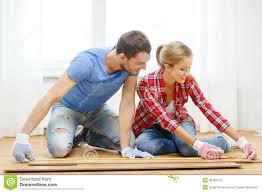 smiling measuring wood flooring stock photo image 39783276