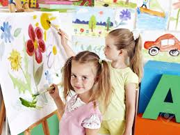 children painting at easel in art class stock photo picture and