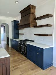 white kitchen cabinets with blue subway tile farmhouse kitchen with open shelving painted blue cabinetry