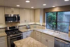 does paint last on kitchen cabinets is it a idea to paint kitchen cabinets pros cons