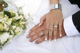 hand with rings images Loving couple holding hands with rings against wedding dress stock jpg